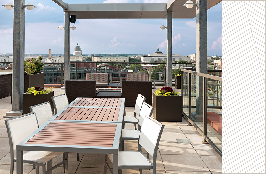 photo of rooftop lounge table and chairs at Parc Riverside apartments with view of Capitol Building
